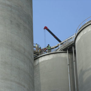 working-atop-140_-high-silos